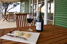 Enjoy a glass of wine on the cottage verandah